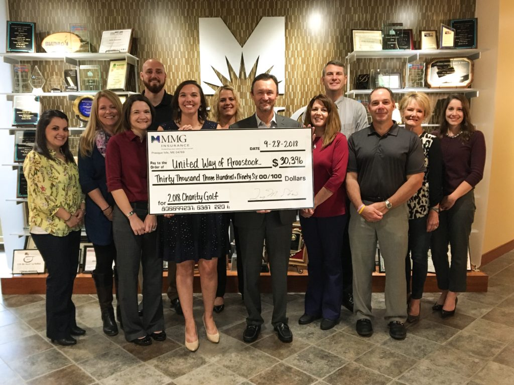 mmg employees holding giant check for united way of aroostook for 2018 charity golf event